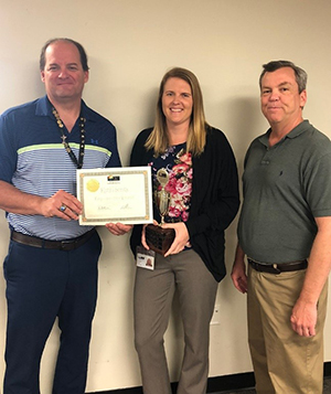 Employee of the Second Quarter 2019, Kathi Sentz, with Tax Collector Ken Burton and Director Tony Conboy