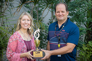 Lillie Robinson Humanitarian Award recipient Tanya Ranney with Tax Collector Ken Burton Jr.